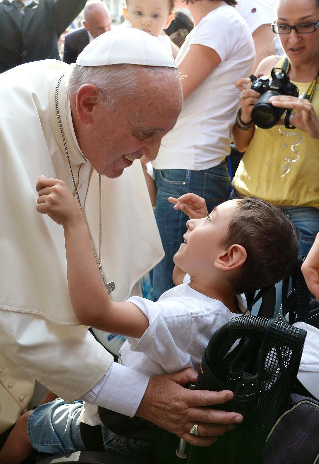 Pope Francis asks: What kind of world do we want to leave to those who come after us, to children who are now growing up? (Photo: Alberto Pizzoli/AFP Getty Images